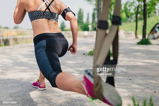 Woman doing suspension workout.
