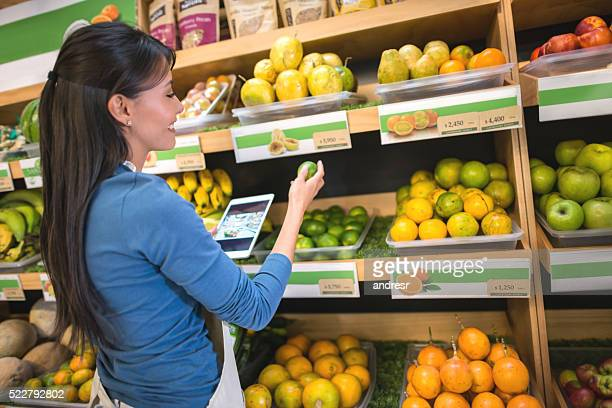 Woman doing the inventory at a supermarket