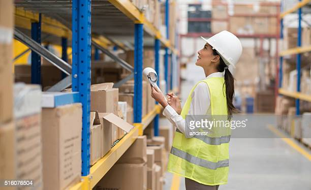 Woman doing the inventory at a warehouse