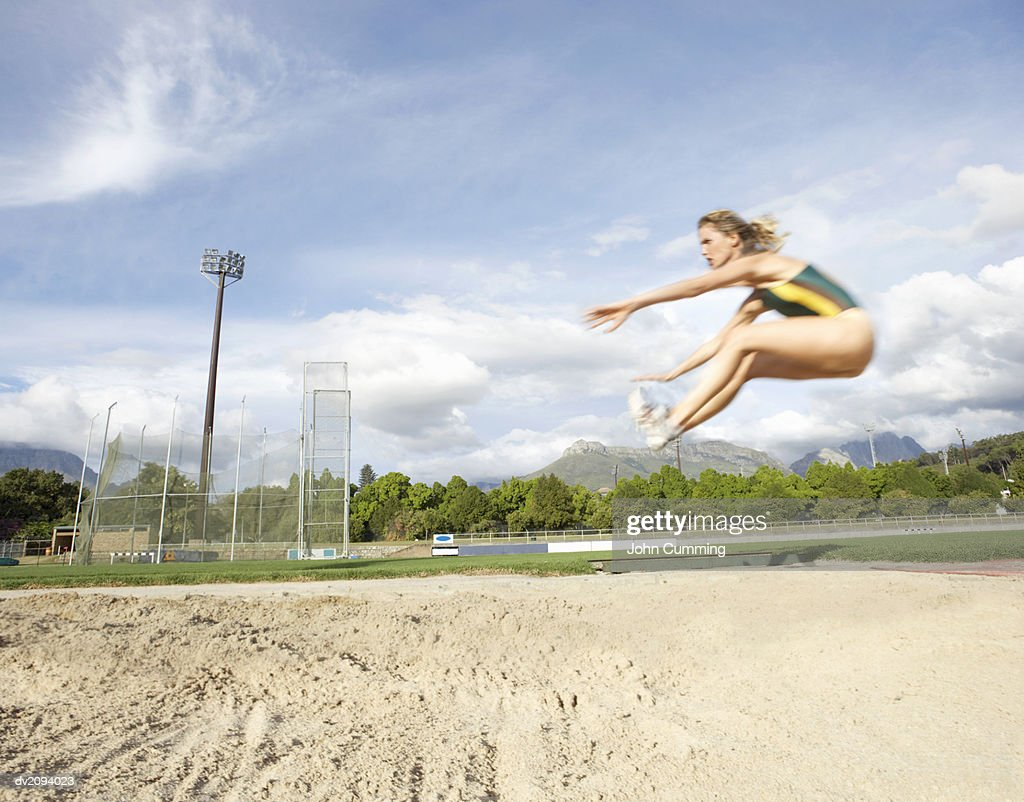 Woman Doing the Long Jump : Stock Photo