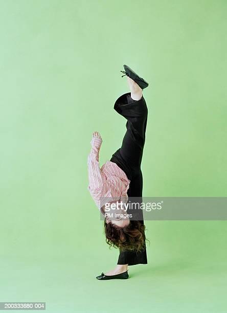 Woman doing the split, standing, portrait