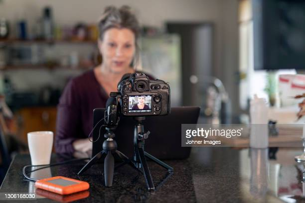 woman doing video blogging - västra götaland county stock pictures, royalty-free photos & images