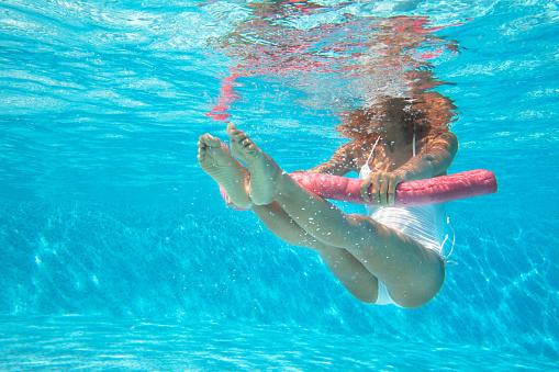 woman doing water aerobics in a pool 913323832
