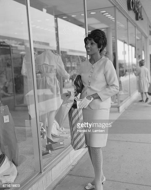 woman doing window shopping - stocking tops stock photos and pictures