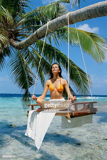 Woman Doing Yoga at Beach