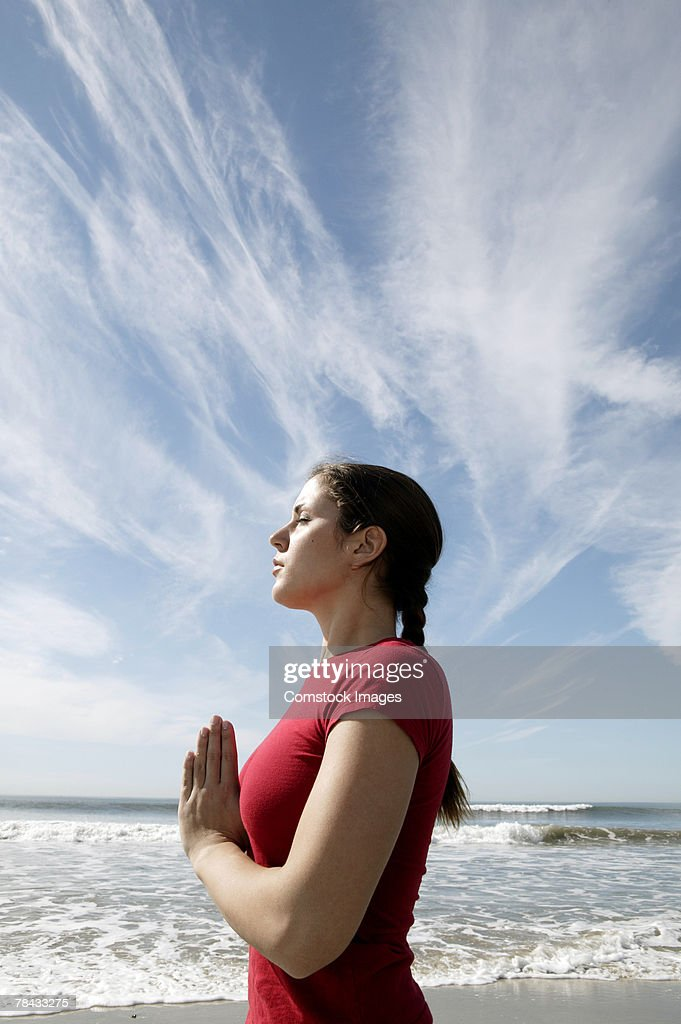 Woman doing yoga at beach : Stock Photo