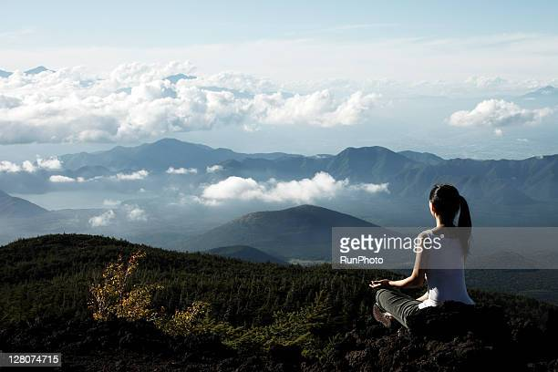 woman doing yoga at the mountain - 自然 ストックフォトと画像