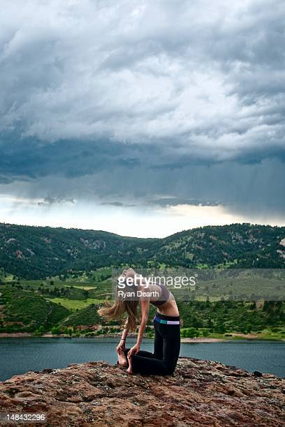 Woman doing yoga by lake