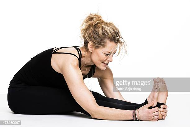 Woman doing yoga exercise on floor