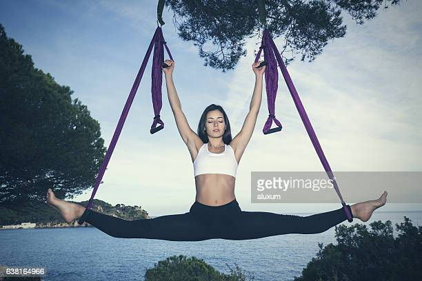 woman doing yoga exercises at the sea - doing the splits stock photos and pictures