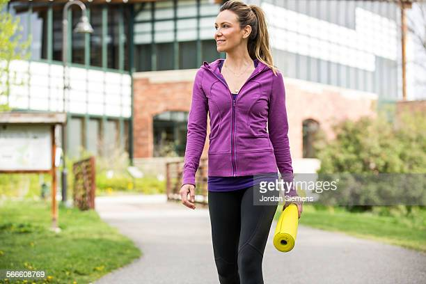 a woman doing yoga in a park. - sports clothing stock pictures, royalty-free photos & images