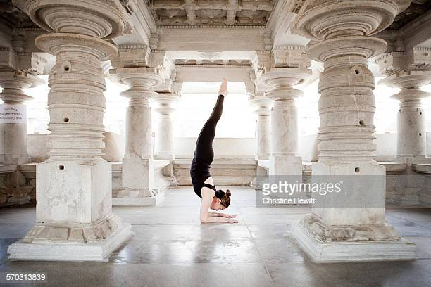 Woman doing yoga in a temple