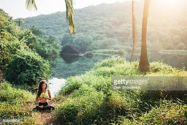 Woman doing yoga in jungles