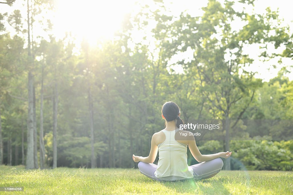 Woman doing yoga in nature : Stock Photo