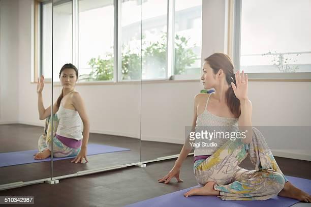 Woman doing yoga in room