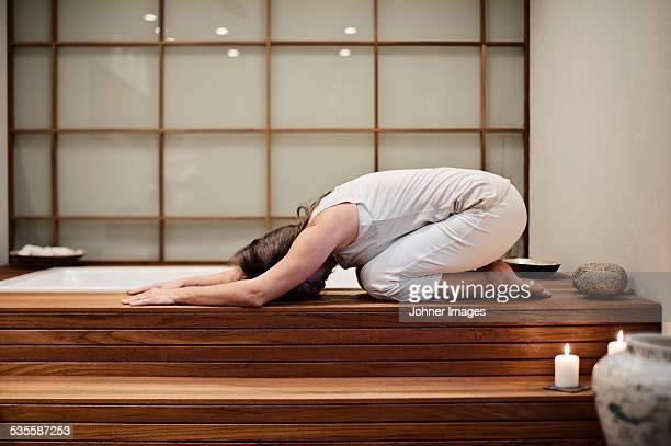 Woman doing yoga in spa