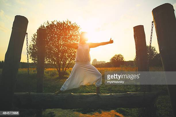 Woman doing yoga in the meadow