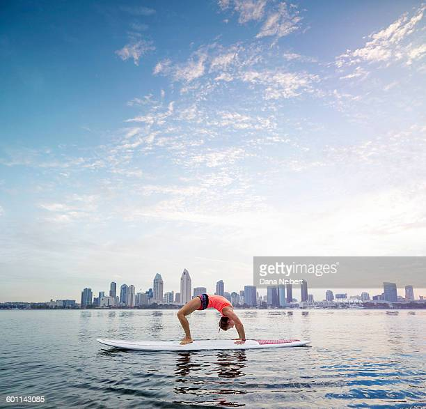 Woman doing yoga on a paddle board in San Diego