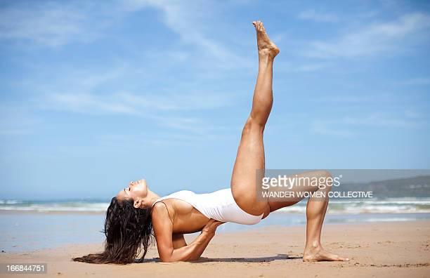Woman doing yoga on Australian beach