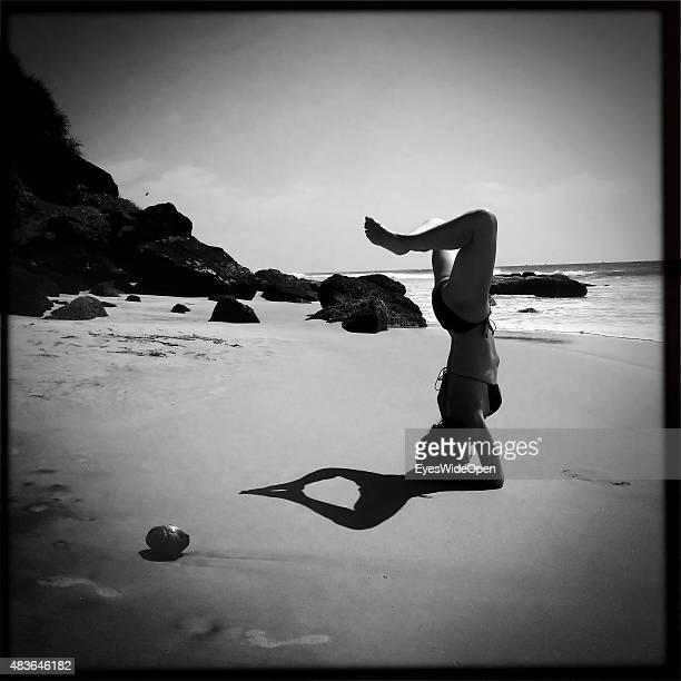 Woman doing Yoga on the beach on December 21 2014 in Varkala Kerala India