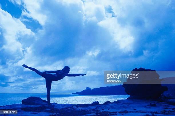 woman doing yoga outdoors - アラベスクポジション ストックフォトと画像