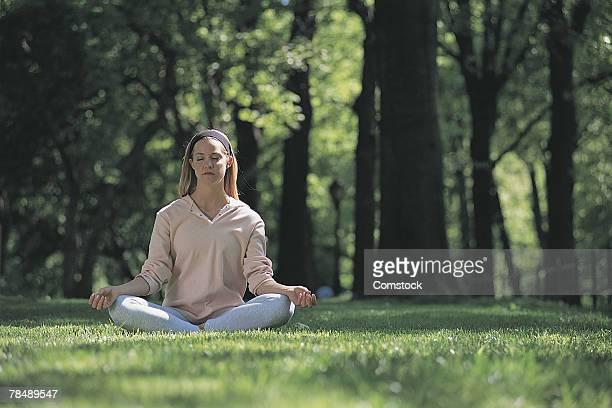 Woman doing yoga outdoors