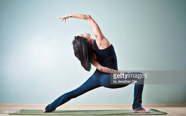woman doing yoga - bending stock pictures, royalty-free photos & images
