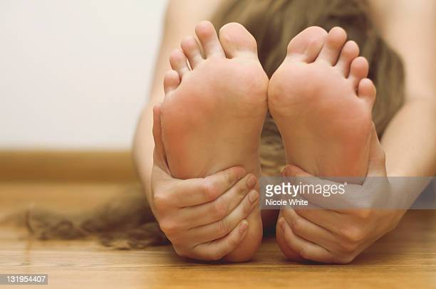 woman doing yoga - soles pose stock photos and pictures