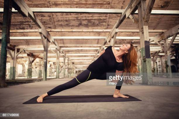 woman doing yoga - older redhead stock pictures, royalty-free photos & images