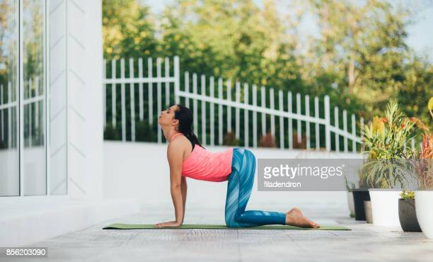 woman doing yoga - good posture stock pictures, royalty-free photos & images