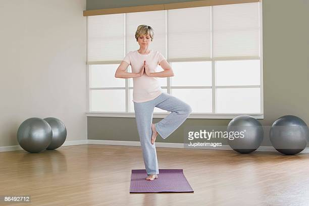 woman doing yoga - standing on one leg stock pictures, royalty-free photos & images