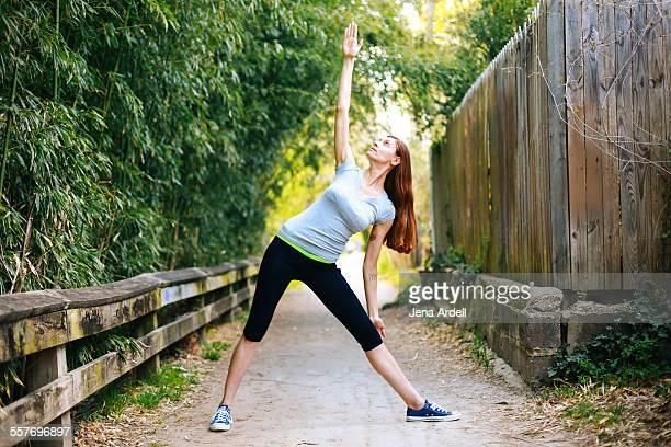 Woman doing yoga pose outside