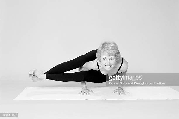 woman doing yoga position - contortionist stock photos and pictures