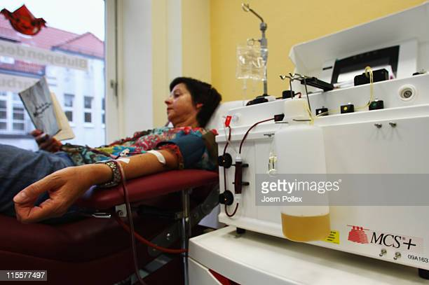 A woman donates blood plasma at the blood donation service Hamburg on June 8 2011 in Harburg Germany Hospitals and the Red Cross in northern Germany...