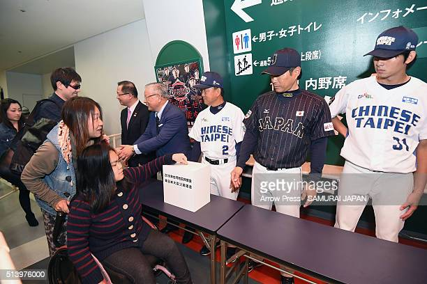 A woman donates for the the victims during the charity session for the Great East Japan Earthquake five years ago and Tainan Earthquake last month...