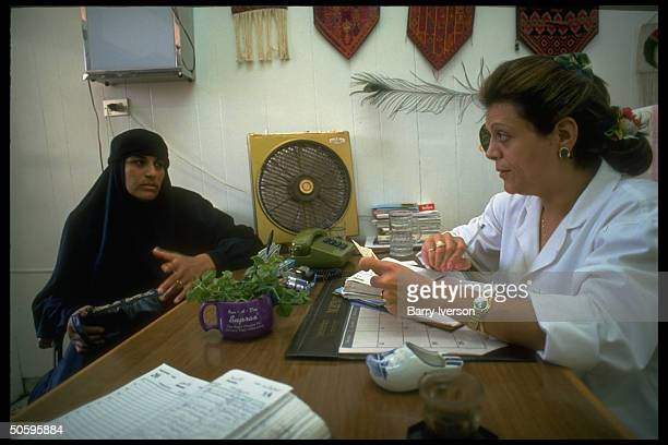Woman dr listening to patient in her office at women's clinic at Palestinian Baqaa refugee camp world's largest housing refugees fr 1948 1967