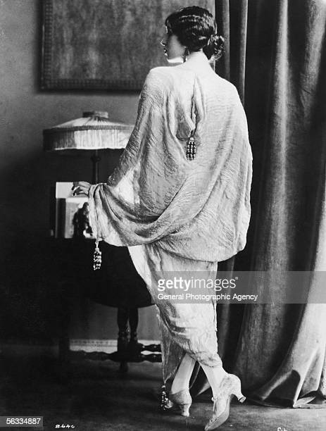 A woman draped in a textured robe with bead ornaments circa 1925