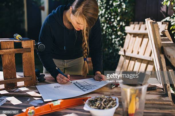 Woman drawing a design sketch