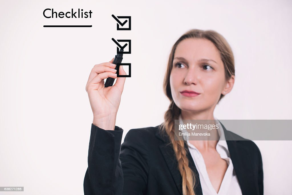 Woman drawing Checklist on board : Stock Photo