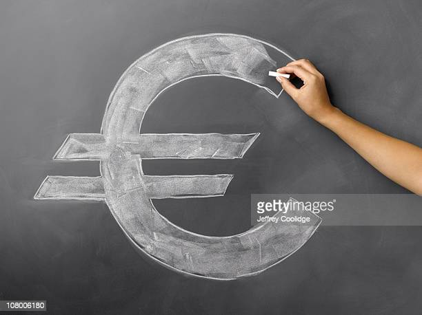 Woman drawing Euro Symbol