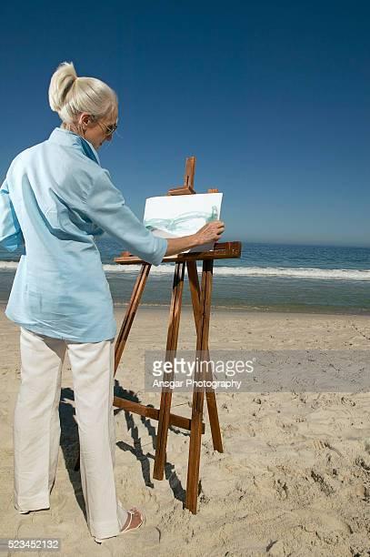Woman drawing on beach