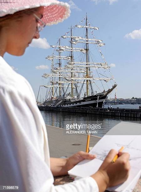 A woman draws the Kruzenshtern sailing ship at a berth in StPetersburg 07 August 2006 Kruzenshtern is the world's second largest sailing ship arrived...