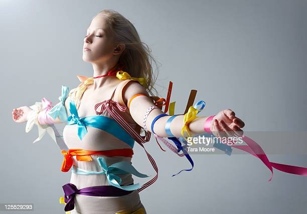 woman dreaming covered with ribbons