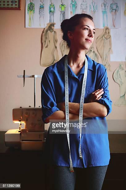 Woman dreaming in fashion design studio
