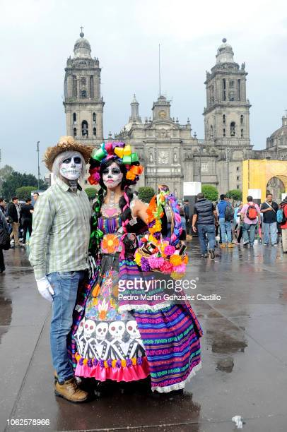 A woman dressed as a Catrina poses as part of the Day of the Dead celebrations at Zocalo on November 1 2018 in Mexico City Mexico