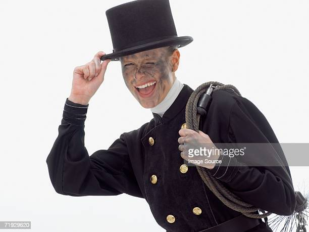 woman dressed as a chimney sweep - schornsteinfeger stock-fotos und bilder