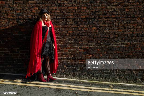 A woman dressed as a goth poses for a photograph during Whitby Goth Weekend on October 28 2018 in Whitby England Whitby Goth weekend began in 1994...