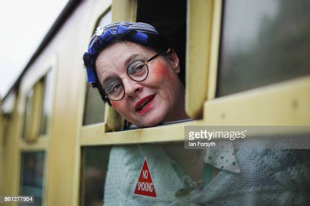A woman dressed as a member of the Land Army looks from a railway carriage window during the North Yorkshire Moors Railway 1940's Wartime Weekend...