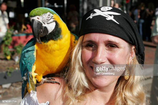 A woman dressed as a pirate with a parrot on her shoulder at the King Mango Strut annual satire parade