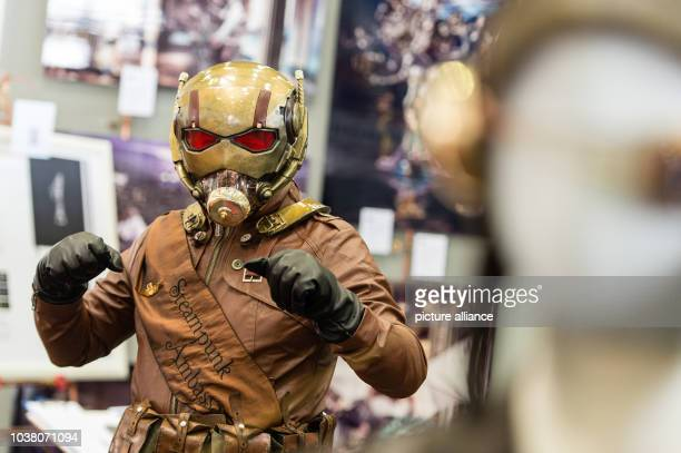 Awoman dressed as a steampunk version of the Marvel character AntMan poses at the MCM Comic Con in HanoverGermany 04 June 2016 Exhibitors stars and...